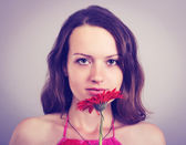 Woman with gerber flower — Stock Photo