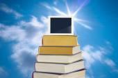 Digital tablet on pile of books — Fotografia Stock