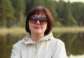 Middle-aged woman in sunglasses — Stock Photo