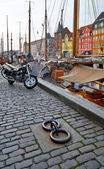 The motorcycle on the Nyhavn paving stone pavement in Copenhagen — Stock Photo