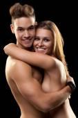 Smiling couple on black — Stockfoto