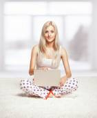 Blonde woman with laptop — Stock Photo
