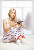 Blonde woman with e-book — Stock Photo