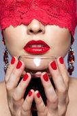 Woman in red ribbon and wine — Zdjęcie stockowe