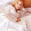 Young  blonde woman in the bed — Stock Photo #65220585