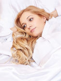 Young  blonde woman in the bed — Stock Photo