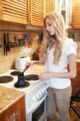 Young blonde woman making coffee — Stock Photo