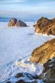 Rock Shamanka on Olkhon island in lake Baikal in winter — Stock Photo