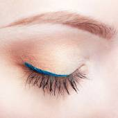 Female eye zone and brows with day makeup — Stock Photo