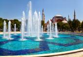 The fontain  in Sultan Ahmet Park with Hagia Sophia in the backg — Stock Photo