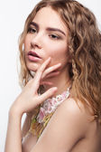 Close-up portrait of teen girl with flower necklace — Stock Photo