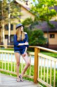 Young woman on small wooden bridge — Stock Photo