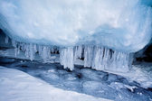 Frozen baikal lake with icicles — Stock Photo