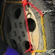 Man putting snow chains on tire — Stock Video #58423623