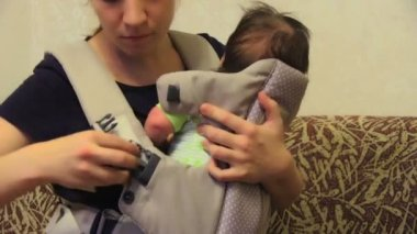 Baby in his carrier — Stock video