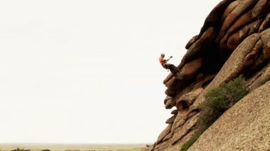 Man Descends From The Top Of The Cliff — Stock Video