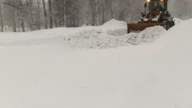 Snowplow removes a lot of snow — Stock Video