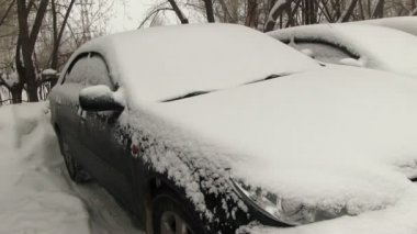 Cars covered with snow on parking — Stock Video