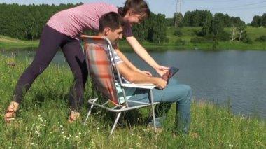 Happy couple with laptop — Stock Video