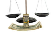 Dollars on the scales — Stock Photo