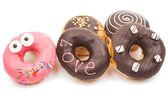 Creative tasty donuts — Stock Photo