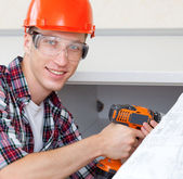 Worker with drill — Stock Photo