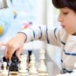 Boy playing a game of chess — Stock Photo #52357689