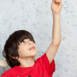 Boy in a red shirt with a wooden plane — Stock Photo #56007783