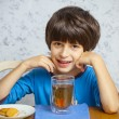 Boy with tea and biscuits — Stock Photo #60528187