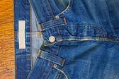 Indigo jeans with a button — Stock Photo