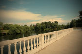 Country landscape with white balustrade — Stock Photo