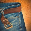 Blue jeans with a leather belt — Stock Photo #62225729