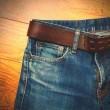 Aged blue jeans with a leather belt — Stock Photo #62531951