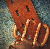 Unfastened old leather belt with vintage buckles — Stock Photo
