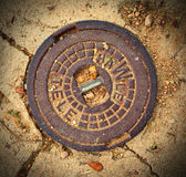 Manhole cover in Tossa de Mar, Catalonia, Spain — Stok fotoğraf