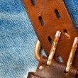 Unfastened old leather belt with vintage buckles — Stock Photo #62982267