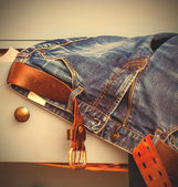 Jeans sticking out of a drawer — Stock Photo