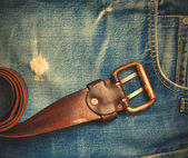 Vintage leather belt on old jeans — Stock Photo