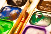 Set of watercolor paints with brush — Stock Photo