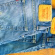 Постер, плакат: Close up of the Levis yellow label on the back pocket of a two p