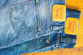 Close up of the Levis yellow label on the back pocket of a two p — Stock Photo