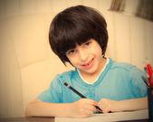 Child doing homework with computer, portrait — ストック写真