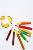 Set of a old colored pencils with shavings — Stock Photo
