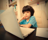Boy with computer, distance learning — Stock Photo