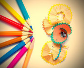 Several colored pencils and shavings — Stock fotografie