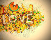 Word Love over a shavings of pencils — Stock Photo