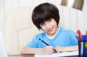 Child doing homework with computer, portrait — Foto de Stock