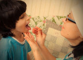 Boy showing his throat to doctor — Stock Photo