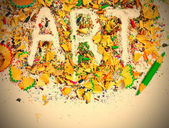 Word Art over a shavings of pencils for drawing — Stock Photo