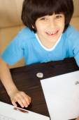 Smiling child doing homework — Fotografia Stock